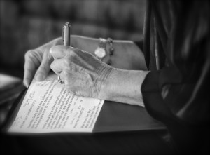 close up of woman writing with pen