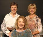 three smiling women storytellers