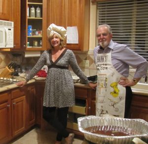Man and woman in chef outfit in kitchen