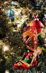 red and green glass cowboy boot tree ornament