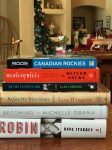 6 books in a pile Robin, Becoming, Before We Were Yours, Musicophilia, Canadian Rockies, Not My Father's Son