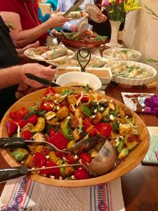 buffet table dishes of vegetables, salads